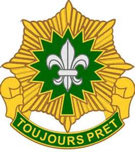 "Yellow and Green Shield with ""Toujours Pret"" written on it."