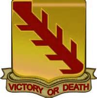 """Gold and Red Shield with """"Victory or Death"""" written on it."""