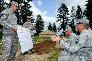 Cadre members from the Leader Development and Assessment Course prepare briefings for the land navigation course June 10, at Joint Base Lewis-McChord. Beginning on June 13, thousands of Cadets from universities across the country will begin to arrive to take part in the annual Army ROTC officer corps rite of passage. (U.S. Army photo by Gary Tarelton)