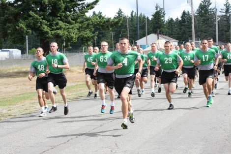 Reserve Officers' Training Corps 6th Regiment Cadets perform the running portion of the Army physical fitness test.