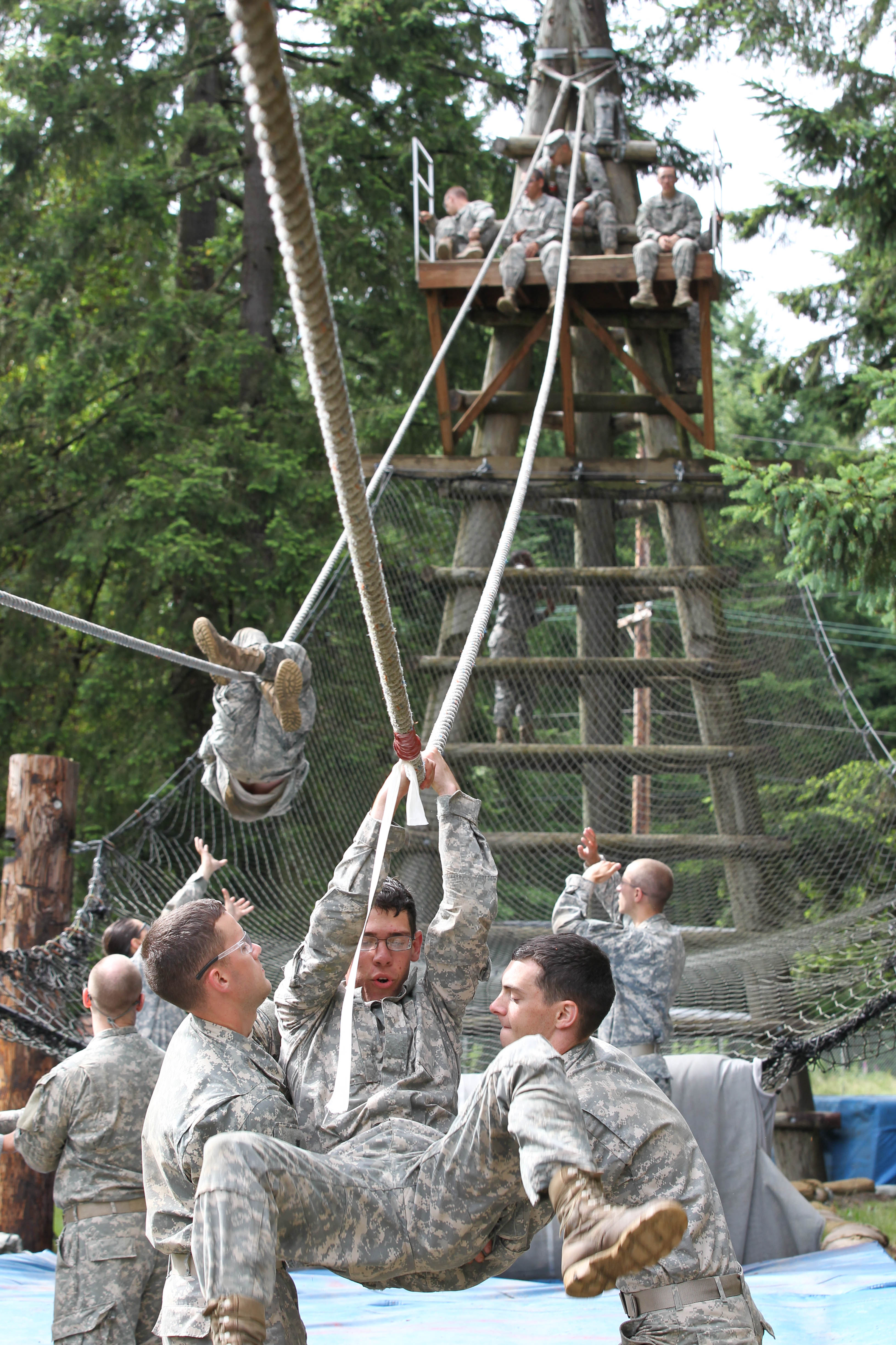 Third Regiment Cadets help one another down from the Inverted Rope Descent at the Confidence Obstacle Course this morning. The course is designed to promote teamwork and build confidence in the Cadets.