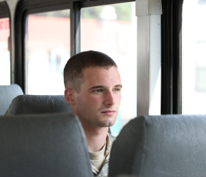 Reserve Officers' Training Corps Cadet Connor Maher, a political science student from Boston University in Boston, Mass., rides on a military bus June 13 on his way to the Leader Development and Assessment Course at Joint Base Lewis-McChord. The course is a 29-day scenario-driven training exercise used to teach Cadets the foundations of military leadership. (U.S. Army Photo by Joe Finley)